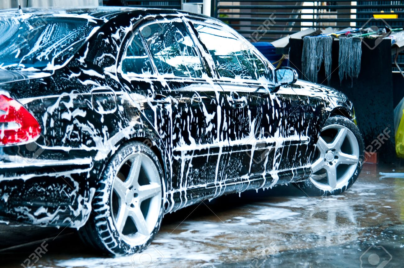 Beauty Black Car With Soap In Car Wash Stock Photo Picture And