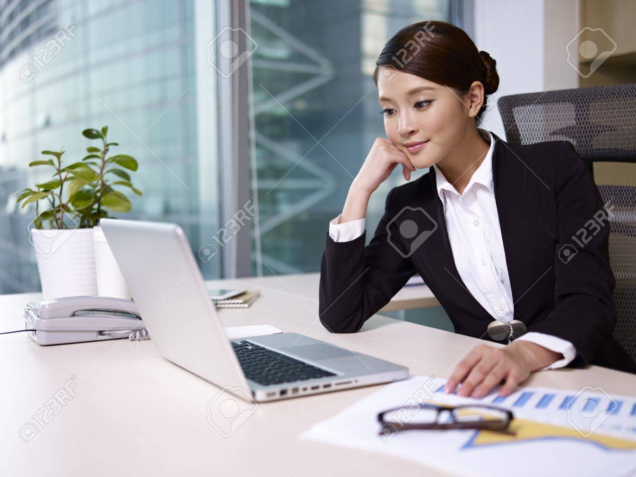 asian businesswoman looking at laptop computer in office Stock Photo - 17974997