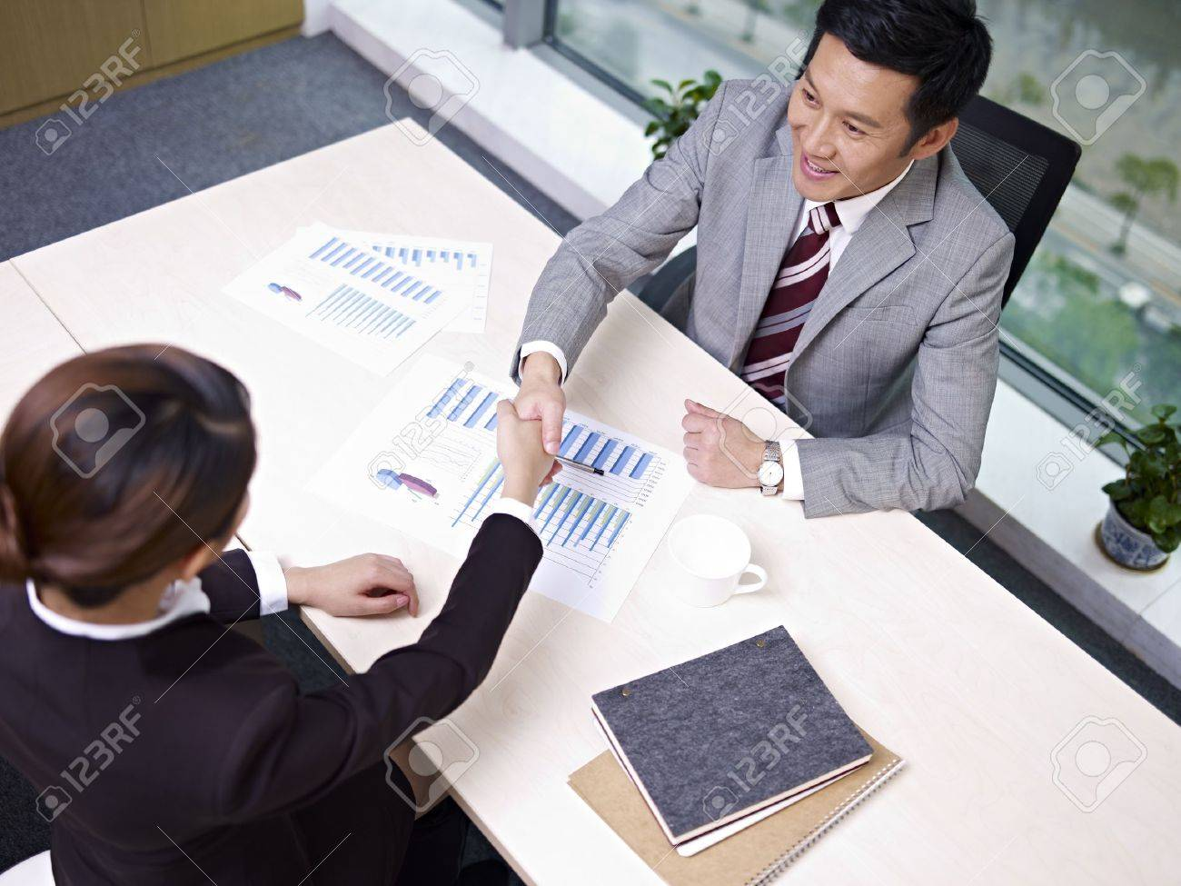 asian business executives shaking hands in office, high angle view Stock Photo - 18194983