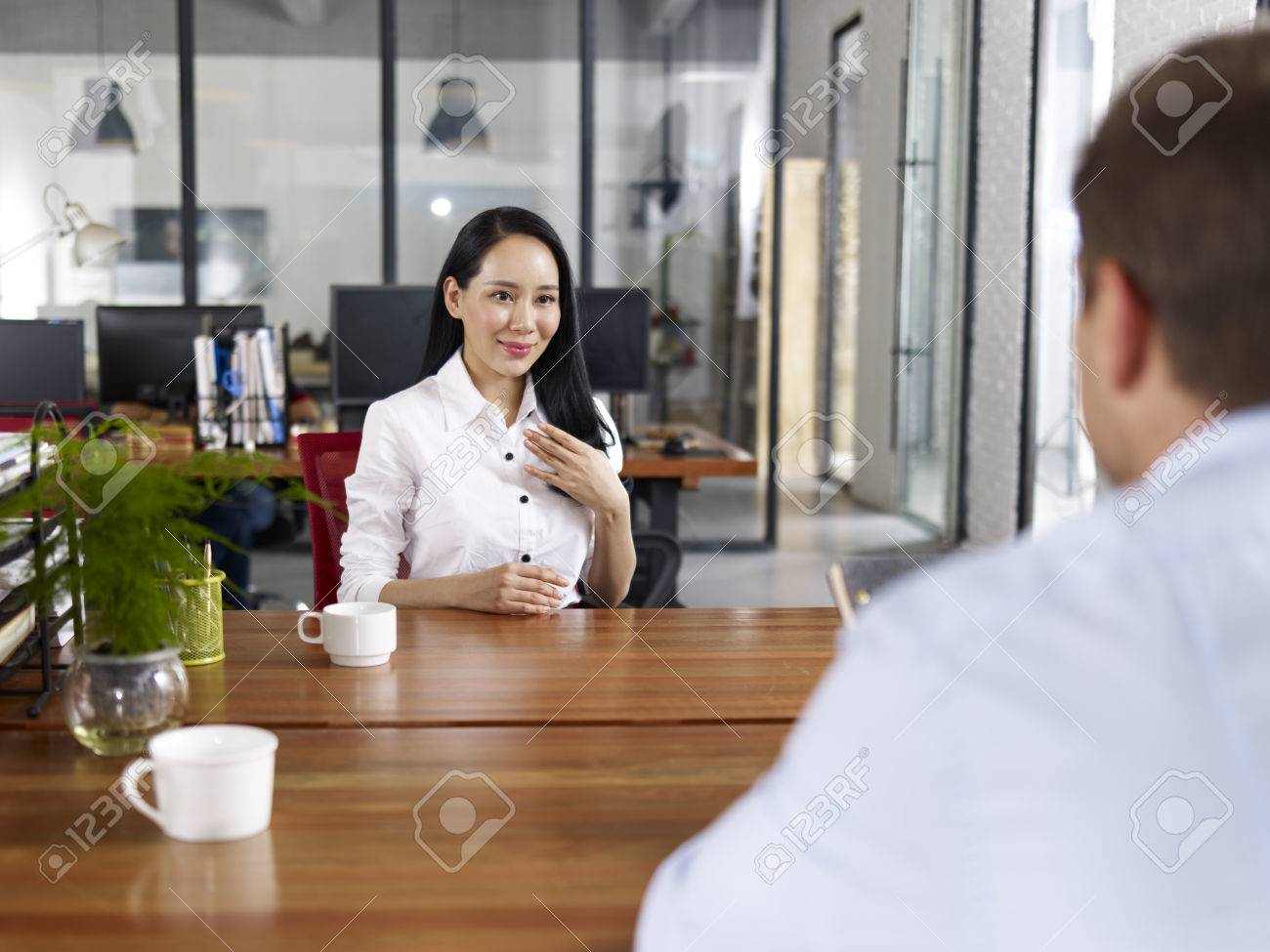 young asian businessw looking confident making a self stock photo young asian businessw looking confident making a self introduction during a job interview