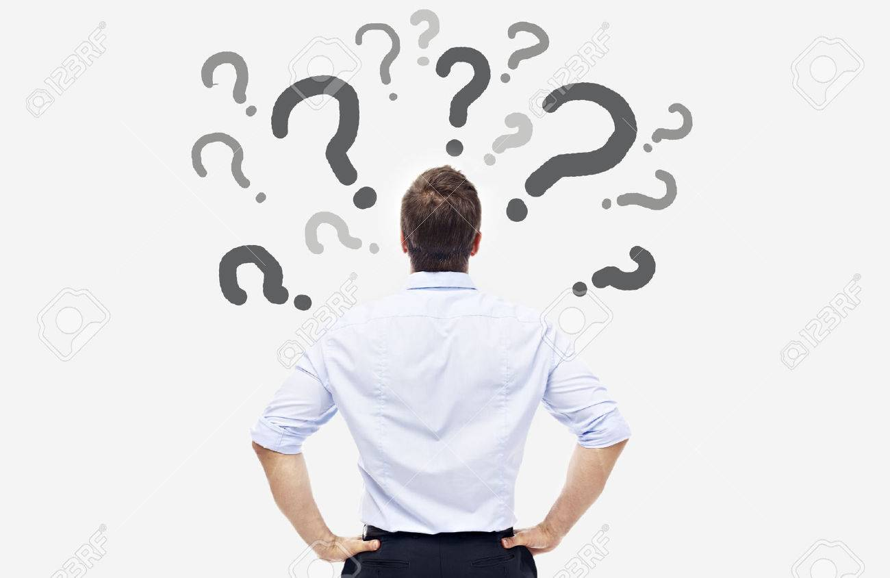 rear view of a caucasian business person looking at the question marks on white board. - 54478442
