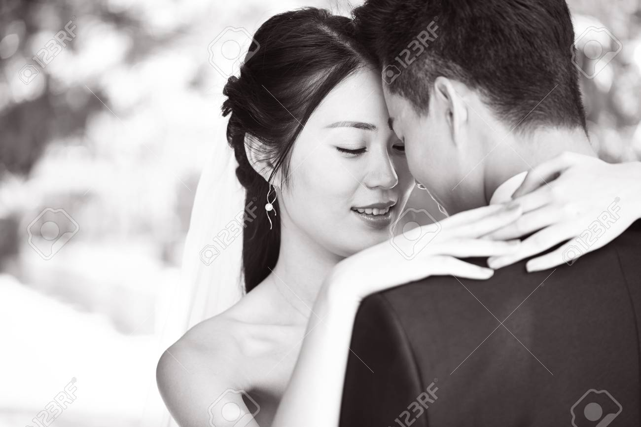 Close up portrait of intimate wedding couple black and white