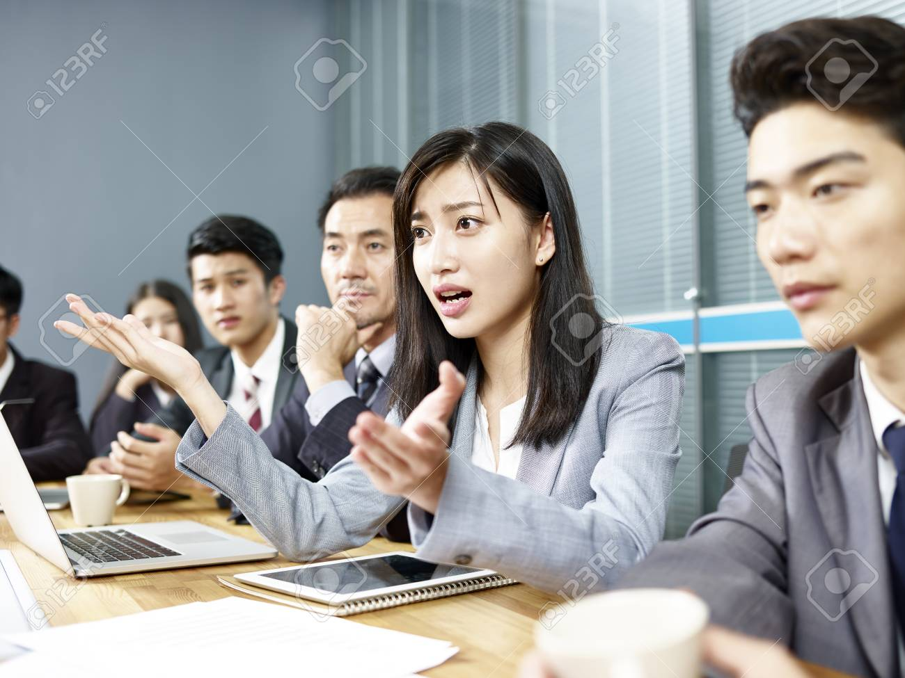 young asian business woman executive engaging in a heated discussion during meeting. - 106415000
