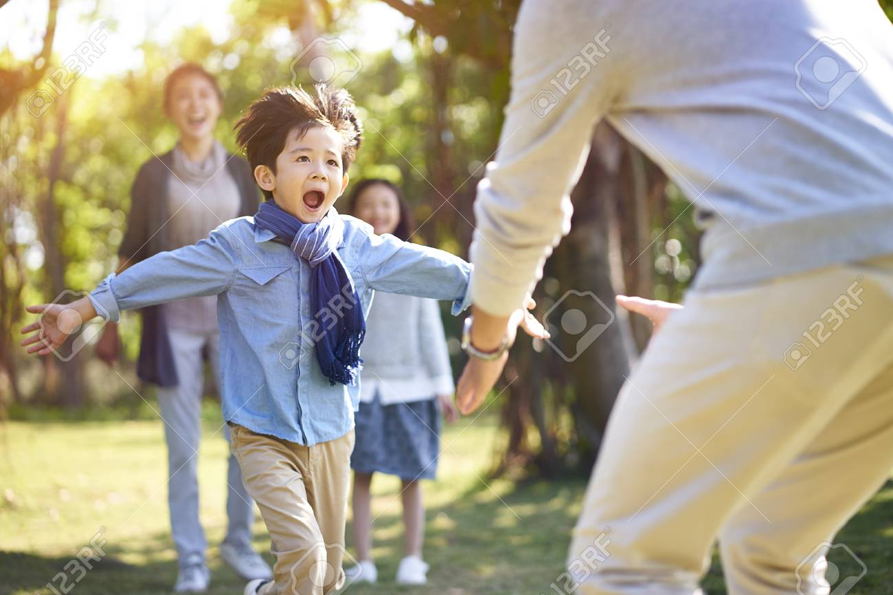 asian little boy son running towards father's embrace. - 115663134