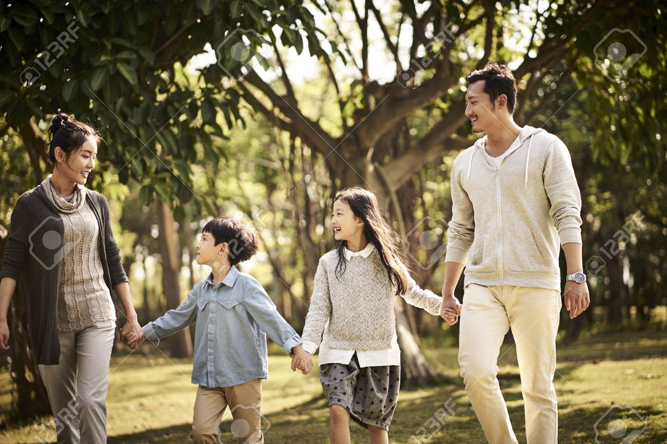 asian family with two children walking relaxing in park happy and smiling. - 115990633