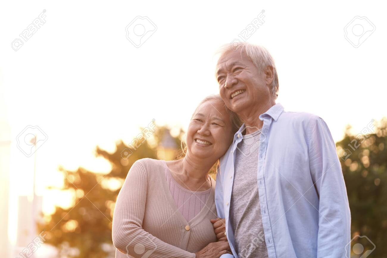 outdoor portrait of loving senior asian couple, happy and smiling - 134198977