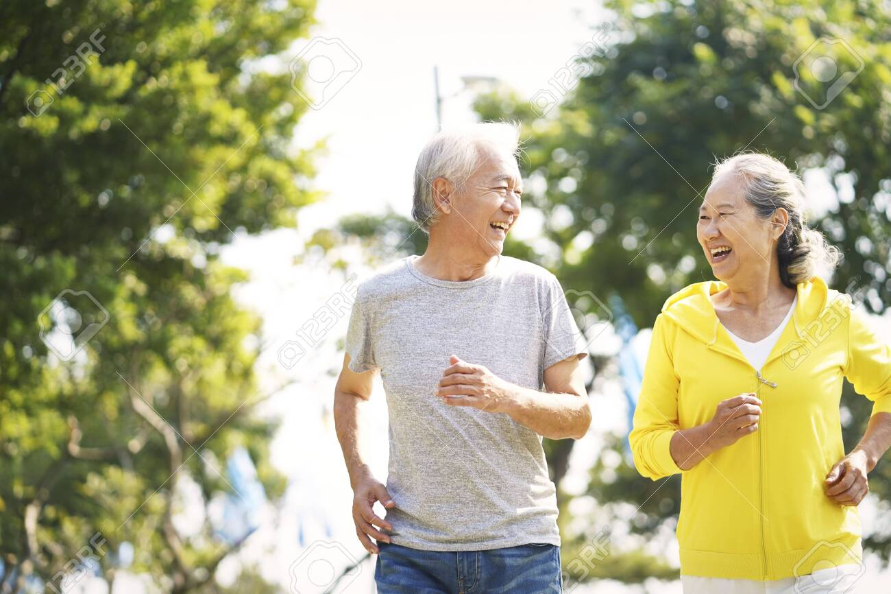 happy asian old couple jogging running outdoors in park - 134926223