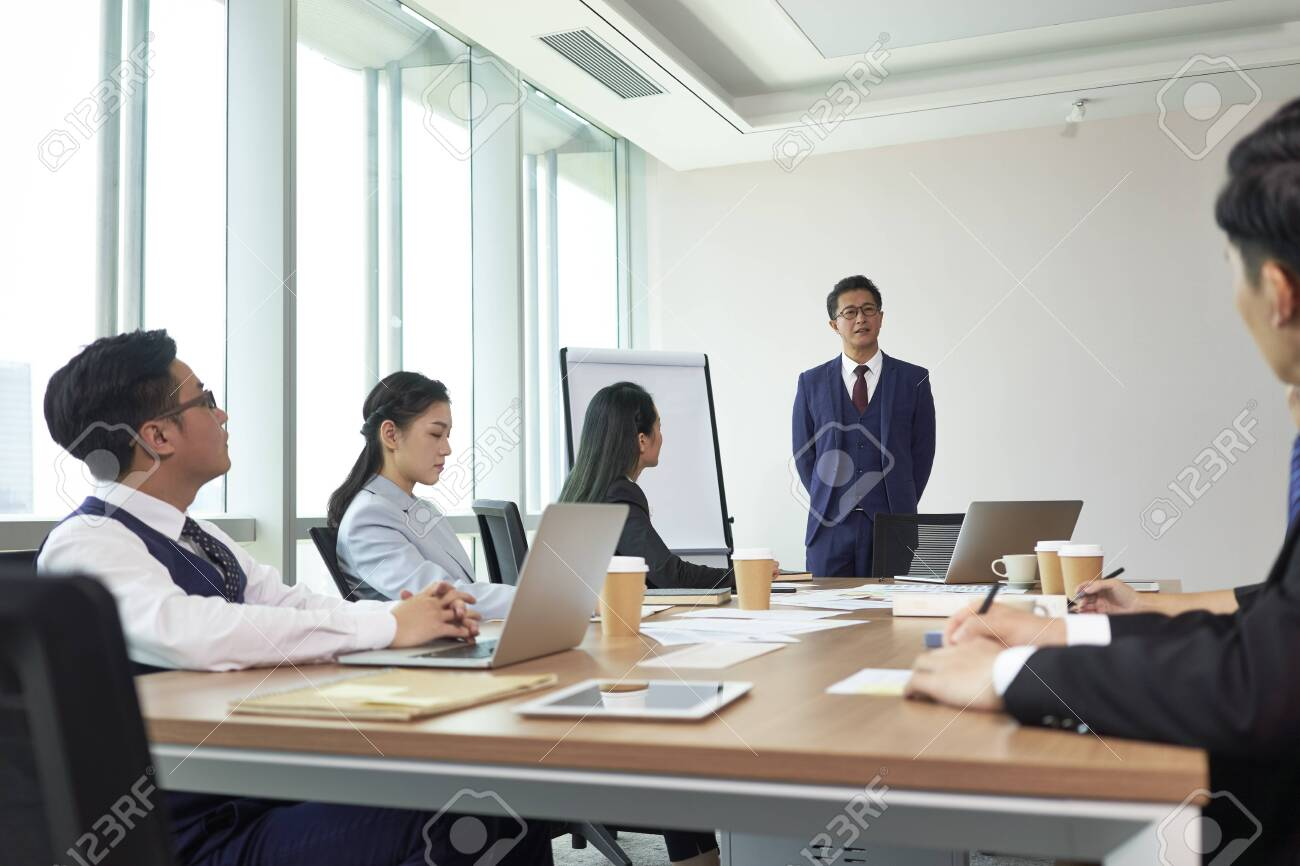 asian boss delivering a speech during meeting in company conference room - 151018867