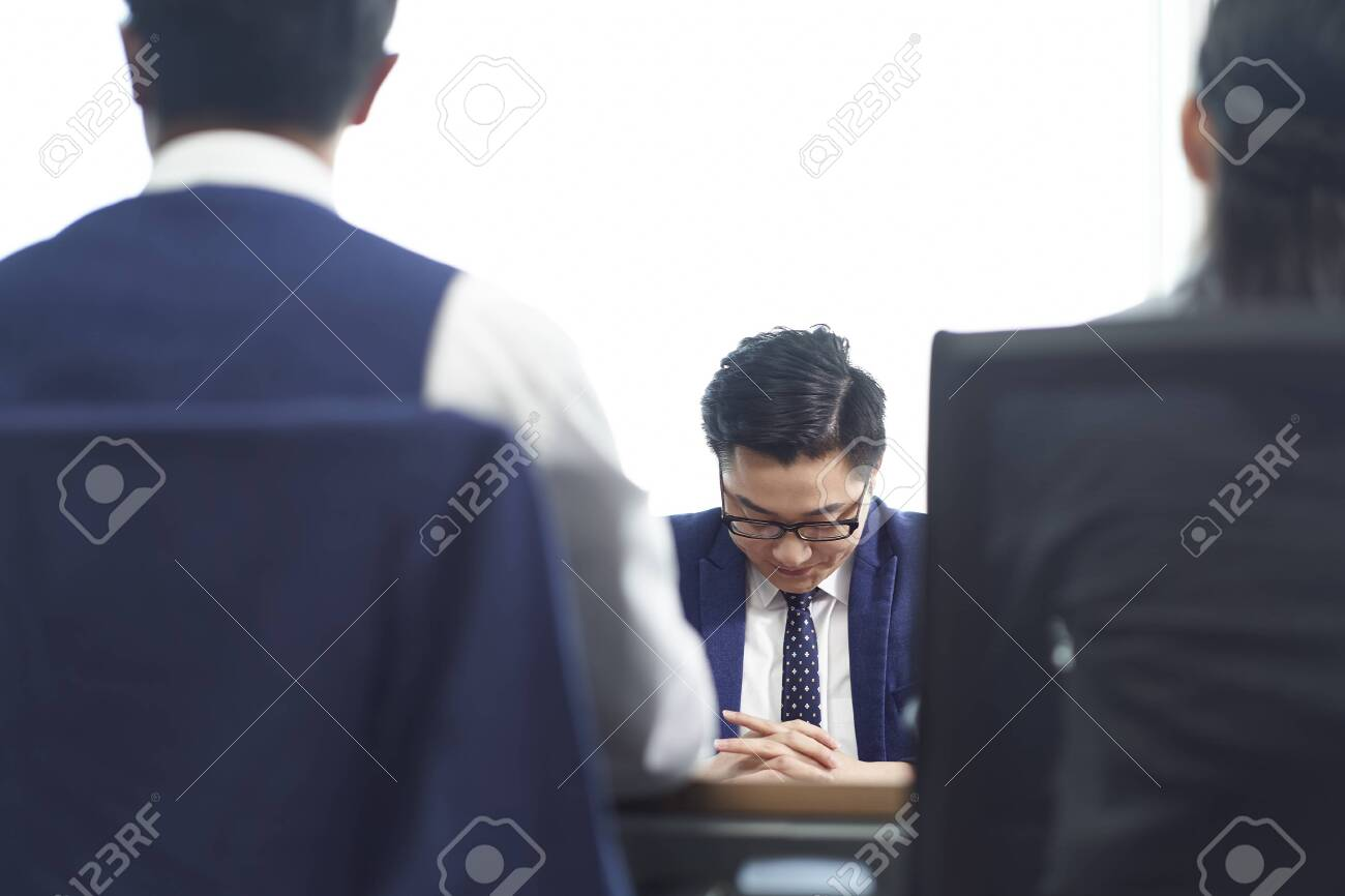 young asian business man looking sad after learning termination of employment - 151018905