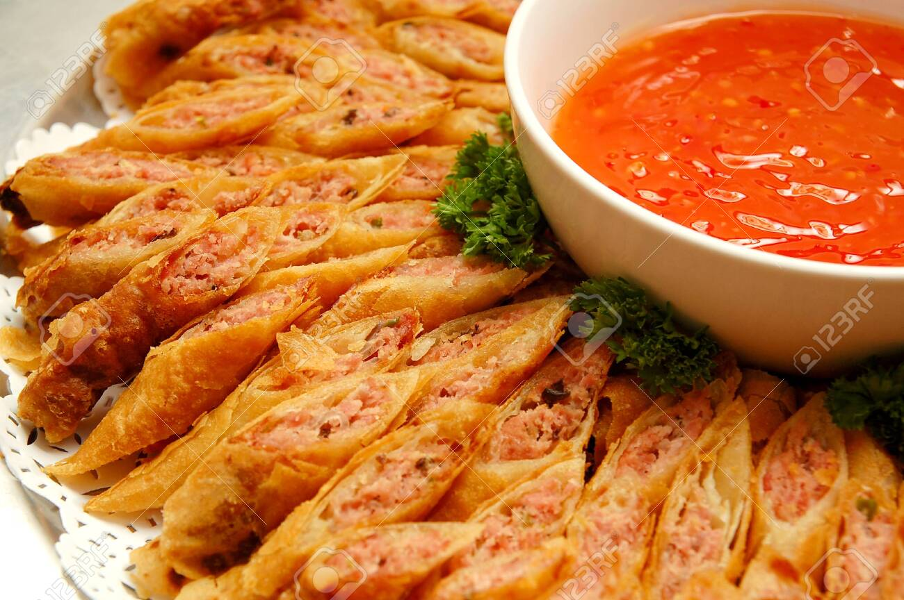 Sliced Lumpia Spring Roll With Sweet Chili Sauce Dip Stock Photo Picture And Royalty Free Image Image 147978755