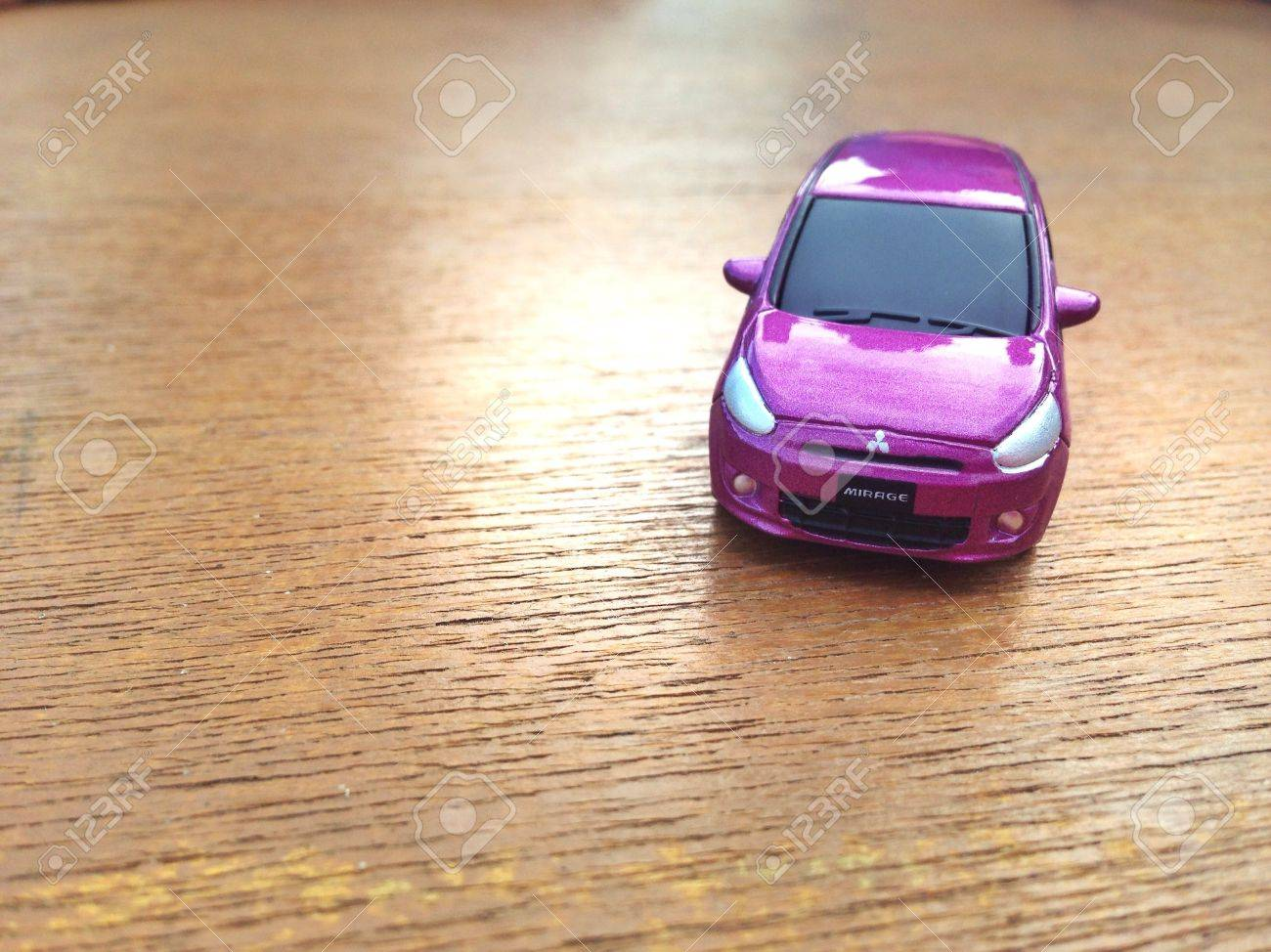 mitsubishi mirage toy car pink stock photo picture and royalty free