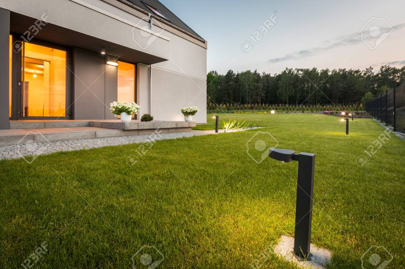 Image of modern villa with garden and decorative outdoor lighting