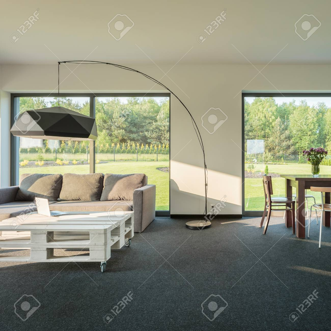 Spacious And Modern Living Room Interior With Big Windows Stock Photo Picture And Royalty Free Image Image 58747096