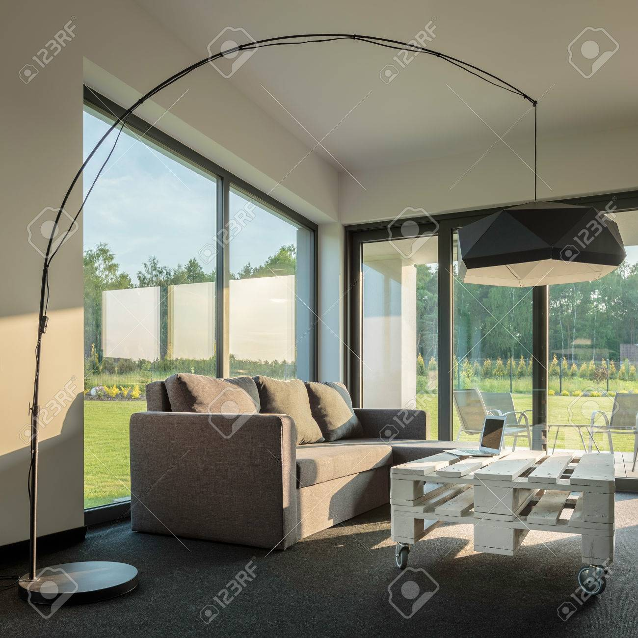 Cozy Living Room With Garden View New Floor Lamp Sofa And White