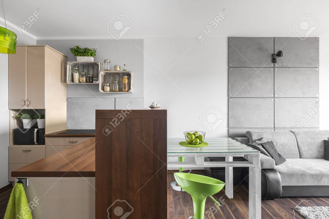 Functional Small Kitchen Open To A Light Living Room With Sofa ...