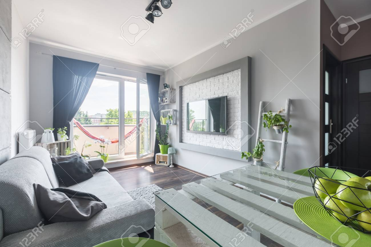 Light Spacious Living Room With Comfortable Grey Sofa, White.. Stock ...