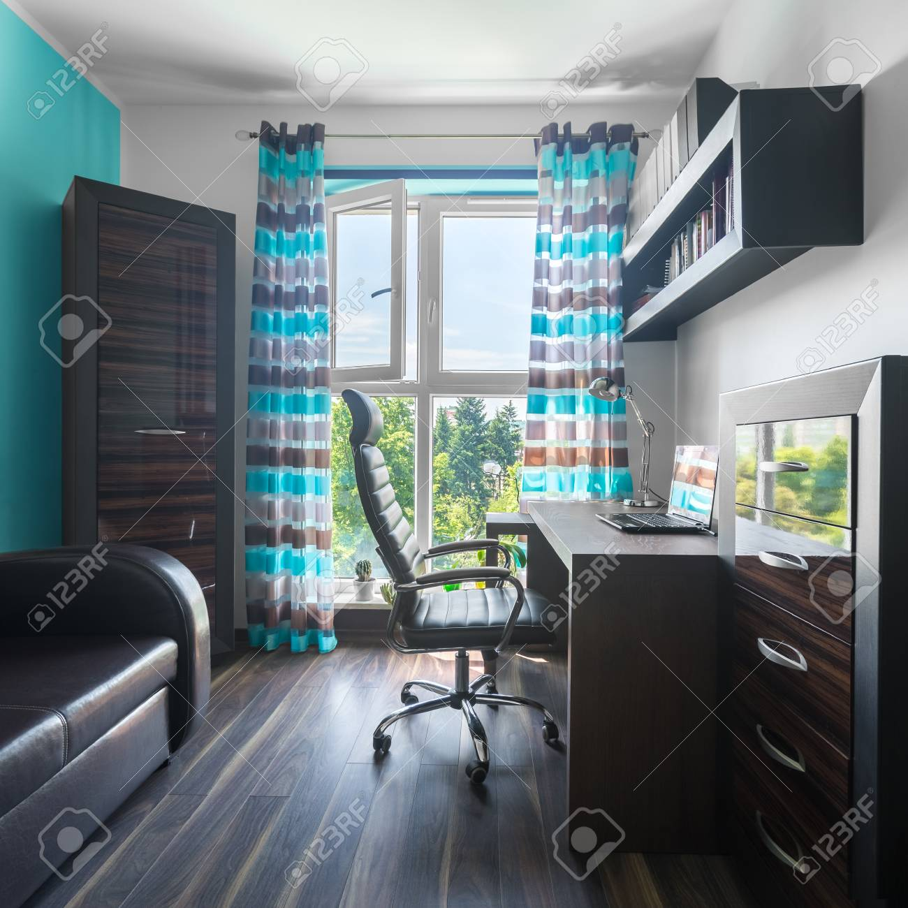 comfortable home office. Spacious Home Office With Brown Furniture, Leather Sofa And Comfortable Armchair In Modern Apartment Stock E