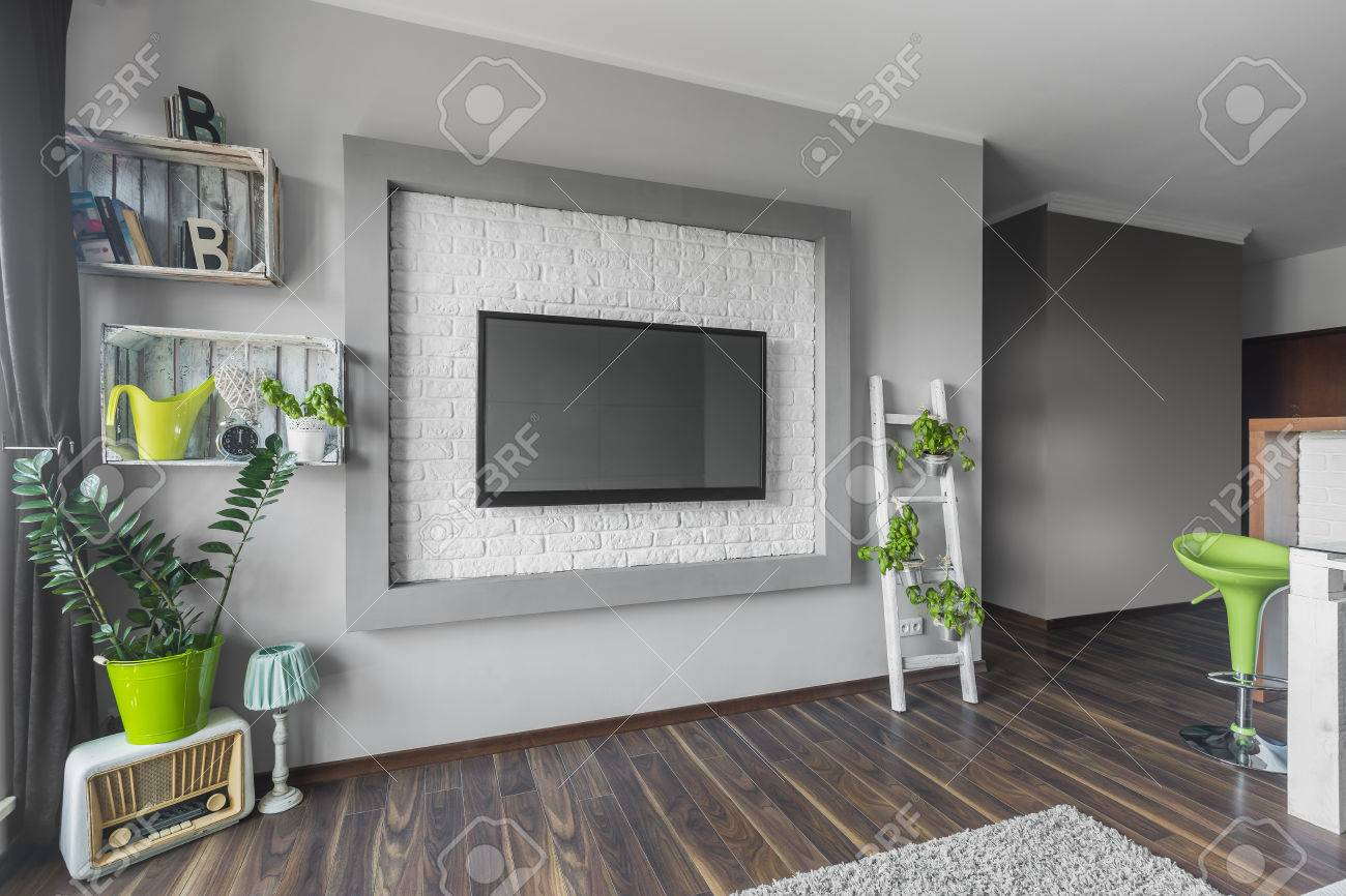 Living Room With Big Tv Hanging On A Decorative Wall With White Stock Photo Picture And Royalty Free Image Image 61823952