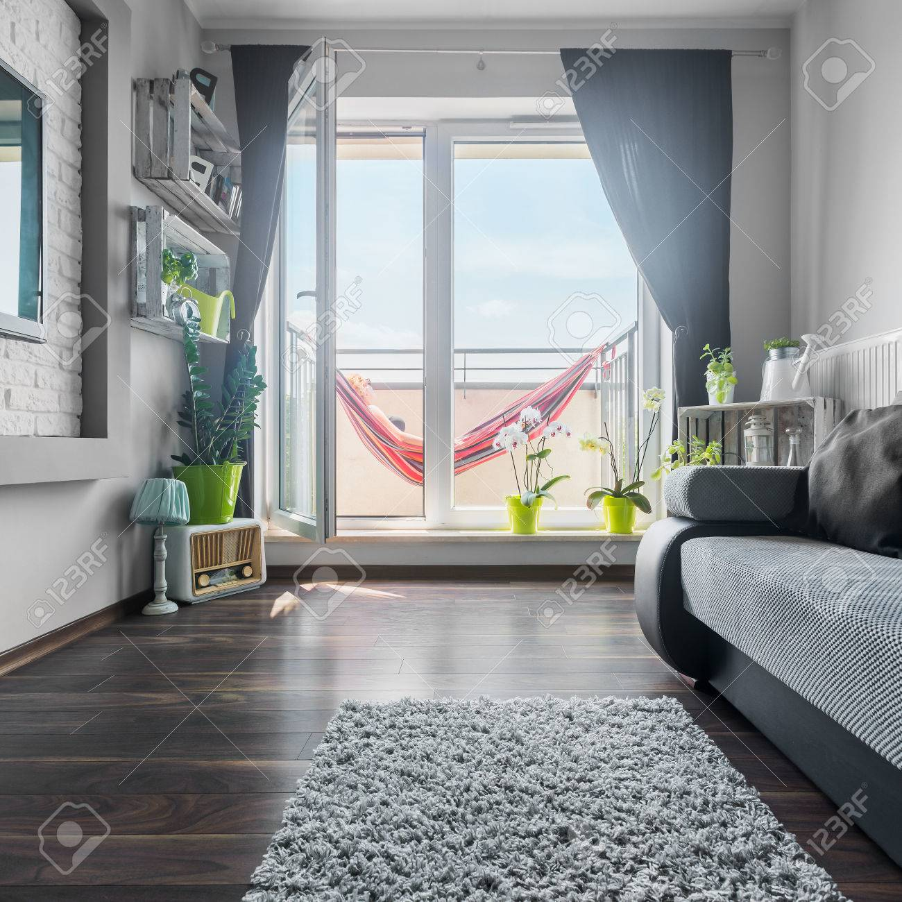 Nice and bright living room in grey and white with sofa, big..