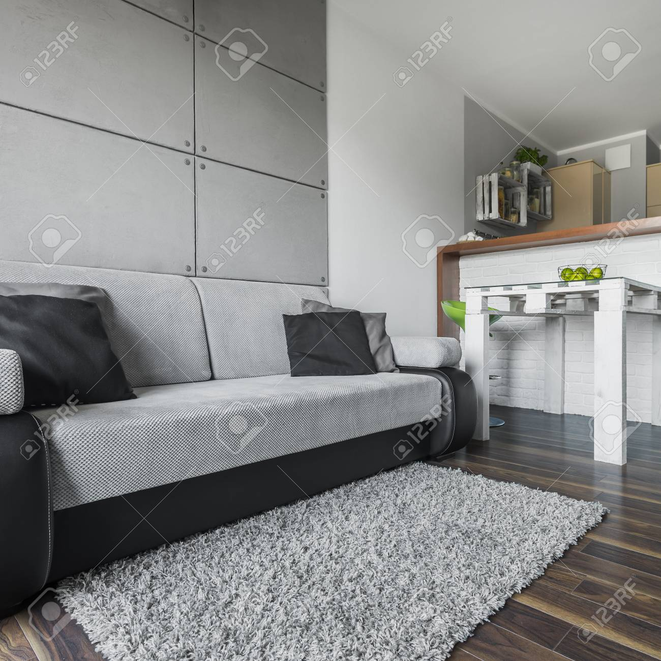 Big And Cozy Grey Sofa In Modern Apartment With Small Dining.. Stock ...