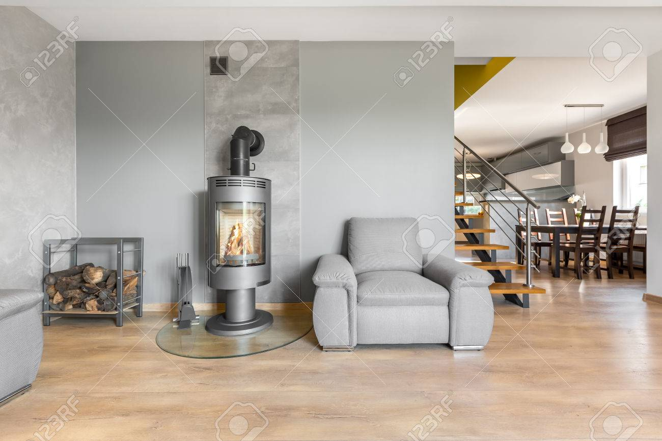 Spacious Living Room With Armchair, Fireplace In Industrial Style ...