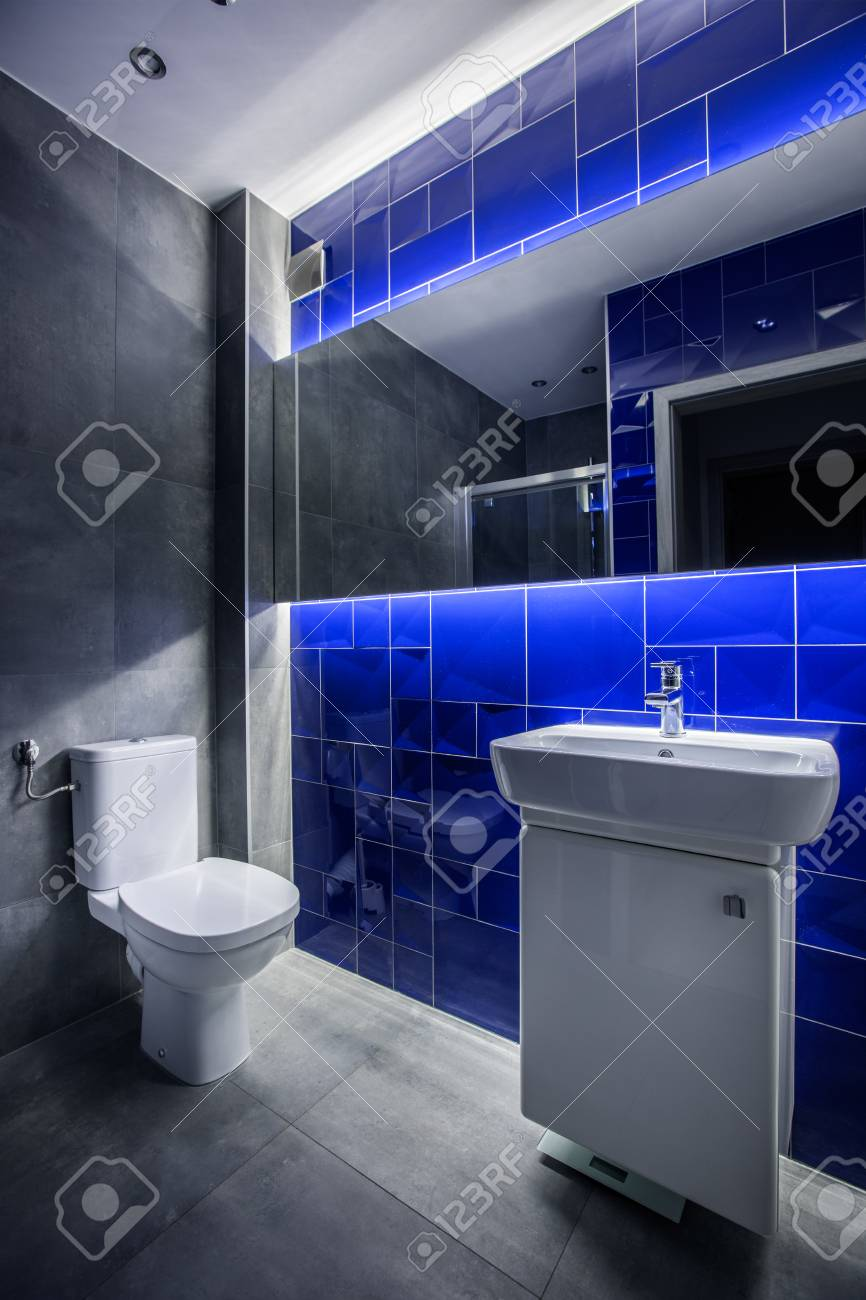 Modern Bathroom With Basin Cabinet, Toilet, Mirror And Tiling ...