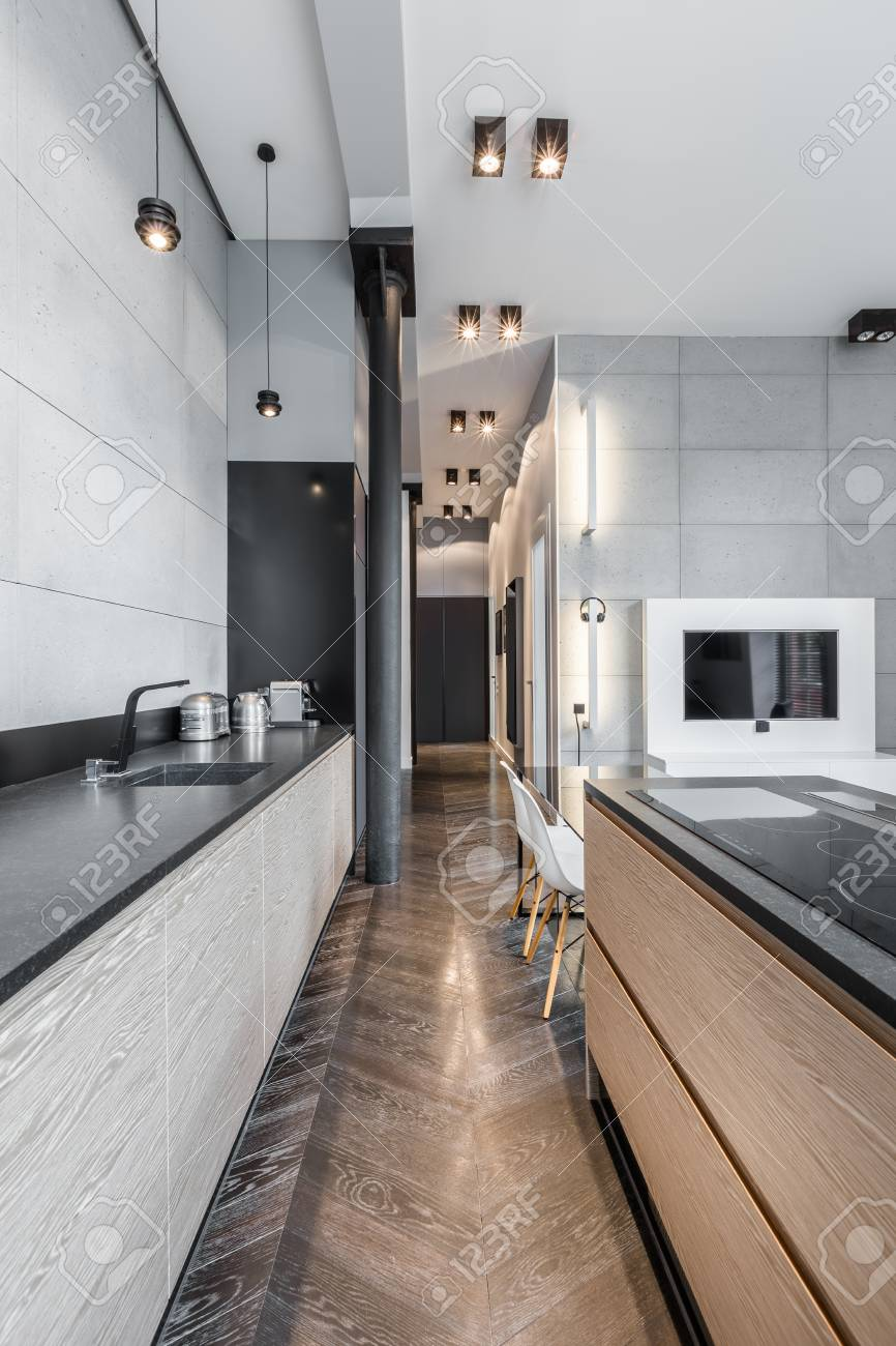 Functional Kitchen With Black Long Worktop And Ceiling Lights Stock Photo Picture And Royalty Free Image Image 66954437