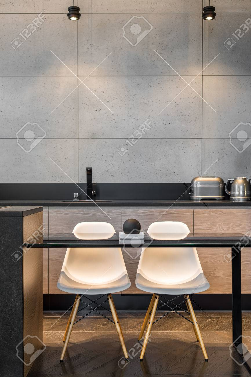 Simple Kitchen Table Two White Chairs And Grey Wall Tiles In Stock Photo Picture And Royalty Free Image Image 67656458