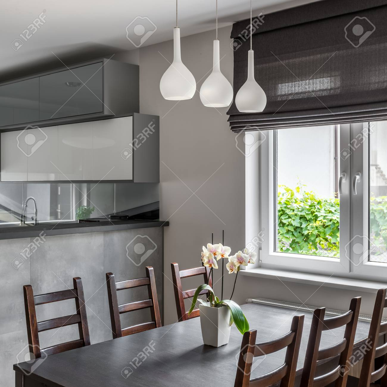 Dining Area With Table Wooden Chairs And Decorative Window Roller Stock Photo Picture And Royalty Free Image Image 69584839