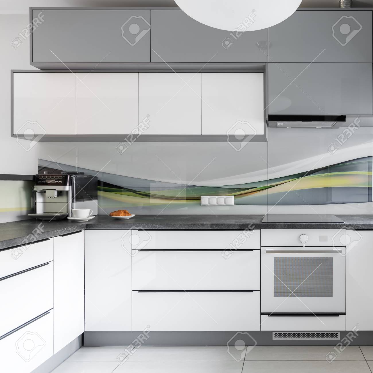 Light Modern Kitchen Interior With White And Grey Furniture Stock