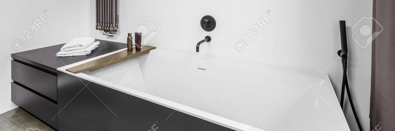 Panorama Of Fancy Bathroom Interior With Bathtub And Wall Heater ...