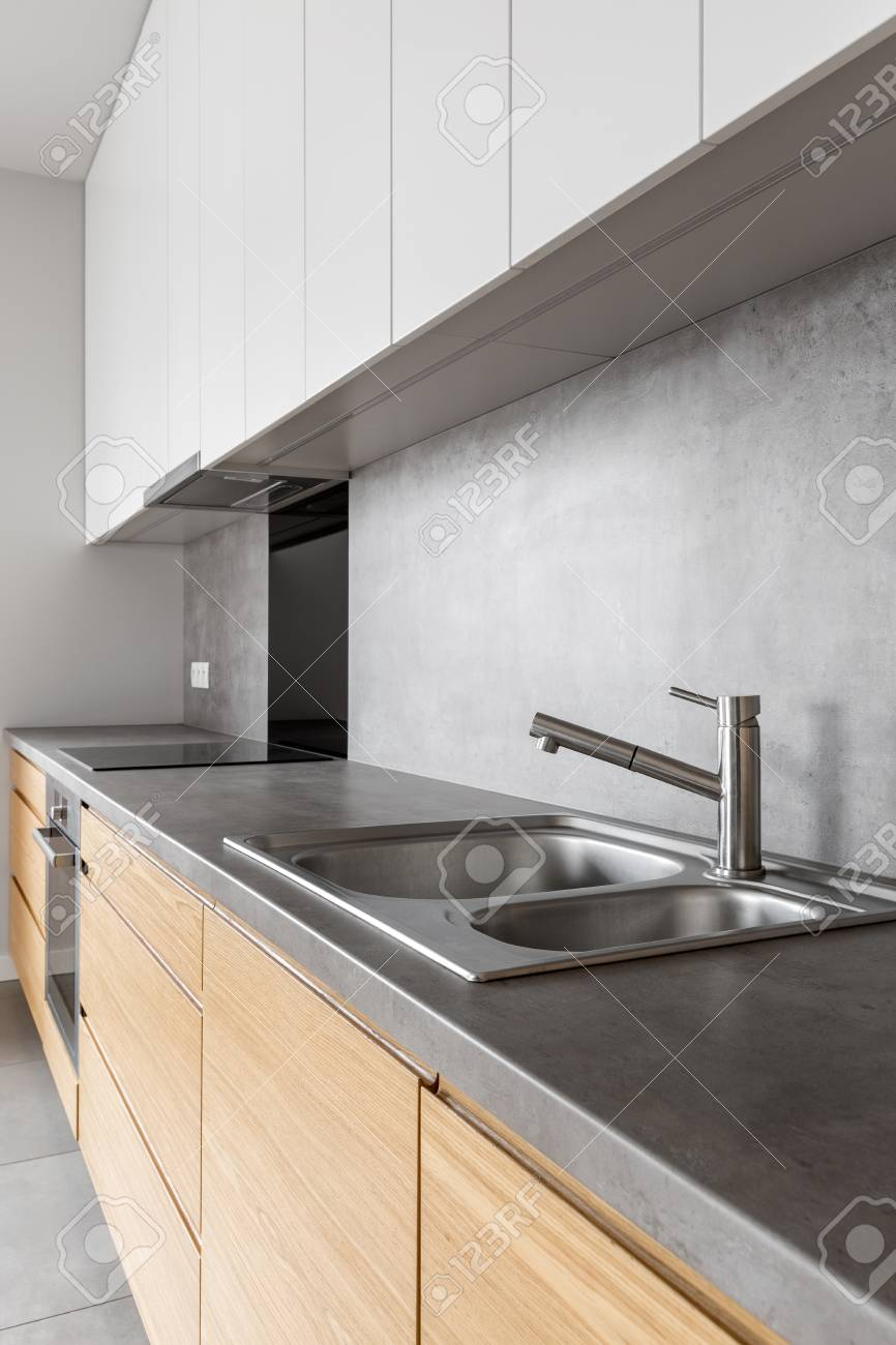 Modern White And Wooden Kitchen Cabinets With Concrete Counter