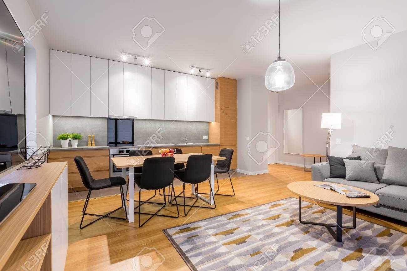 Interior of stylish modern studio apartment with kitchenette