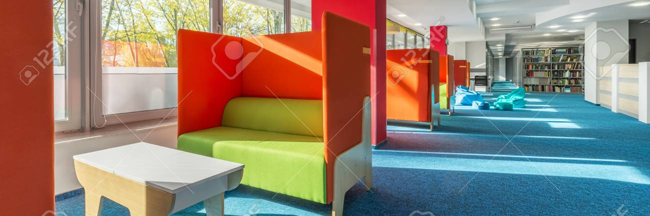 Panorama Of Library Lounge Area With Green Sofas And Red Partitions Stock  Photo   75389084