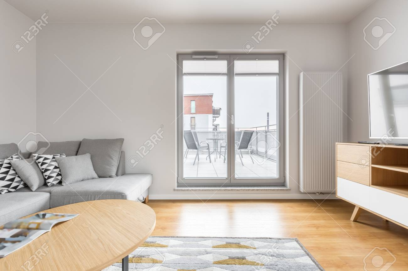 Bright Living Room With Grey Sofa Tv Wooden Cabinet Table Stock Photo Picture And Royalty Free Image Image 75435348