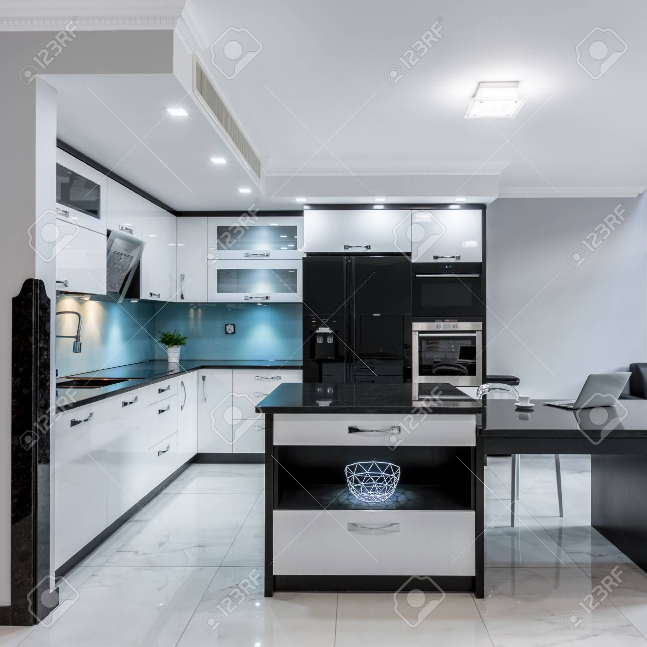 Modern And Luxury Black And White Kitchen Space With Island Stock
