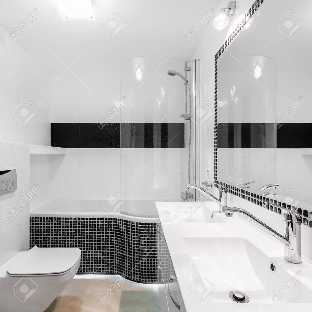 Elegant Bathroom Interior With Modern Black Mosaic Accents And ...