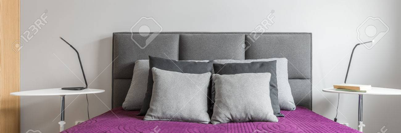 Big Bed With Grey Decorative Pillows And Purple Bedcover In Modern
