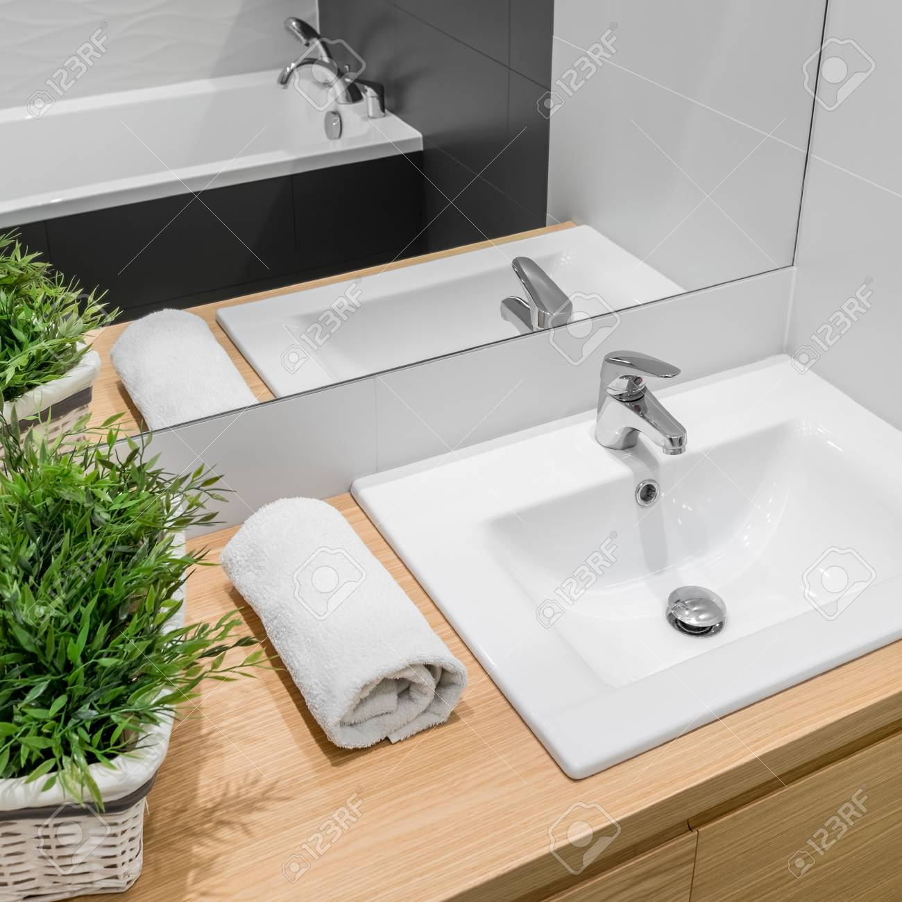 Modern Bathroom With Wooden Cabinet, White Basin, Mirror And.. Stock ...