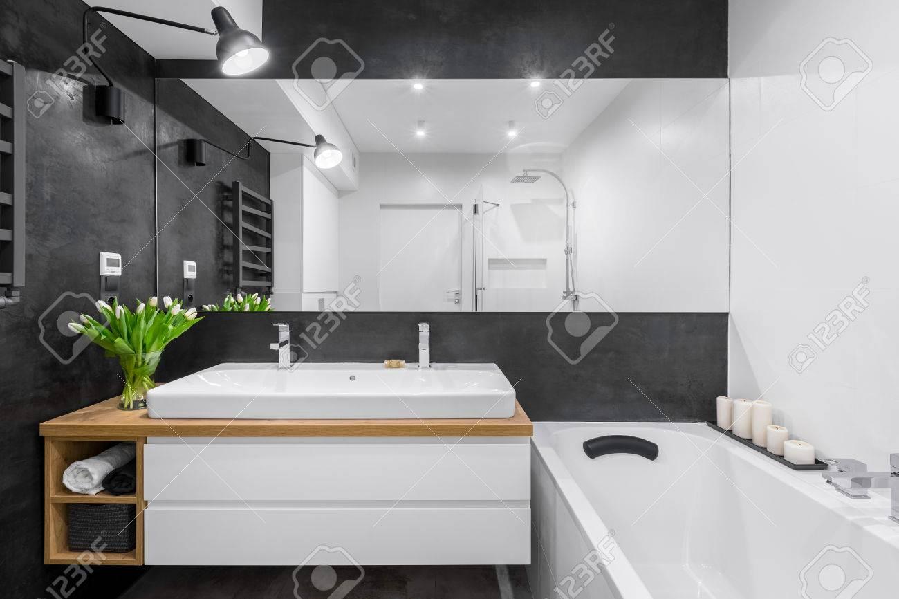 Black And White Bathroom With Big Mirror, Bathtub, Lighting And ...
