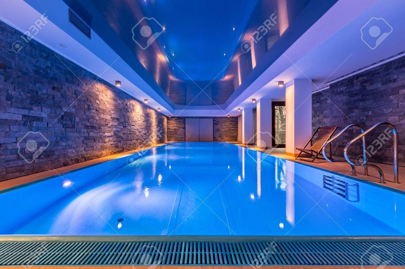 Luxurious villa swimming pool with brick walls, evening view - 79389569