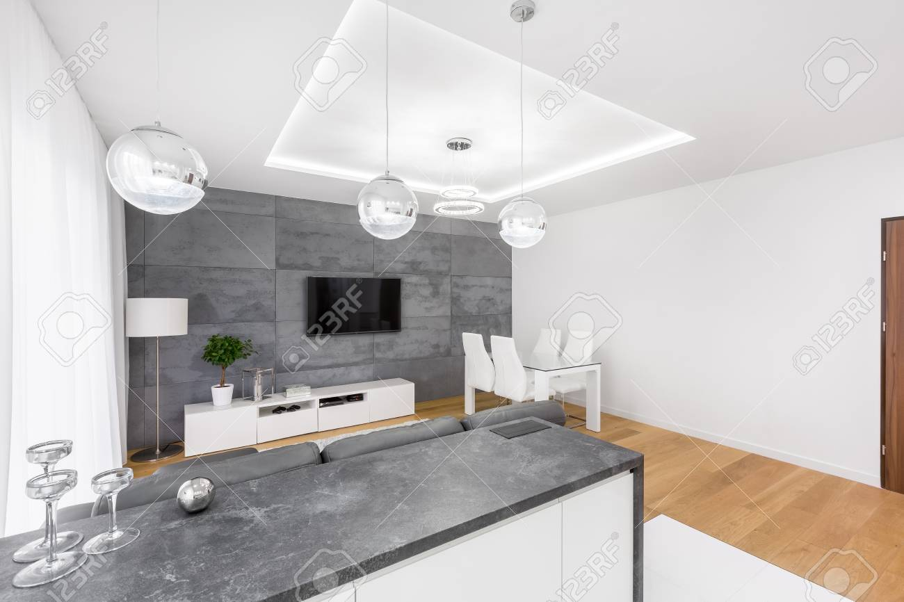 Modern Living Room With Dropped Ceiling, Tv, Lamps And Concrete ...