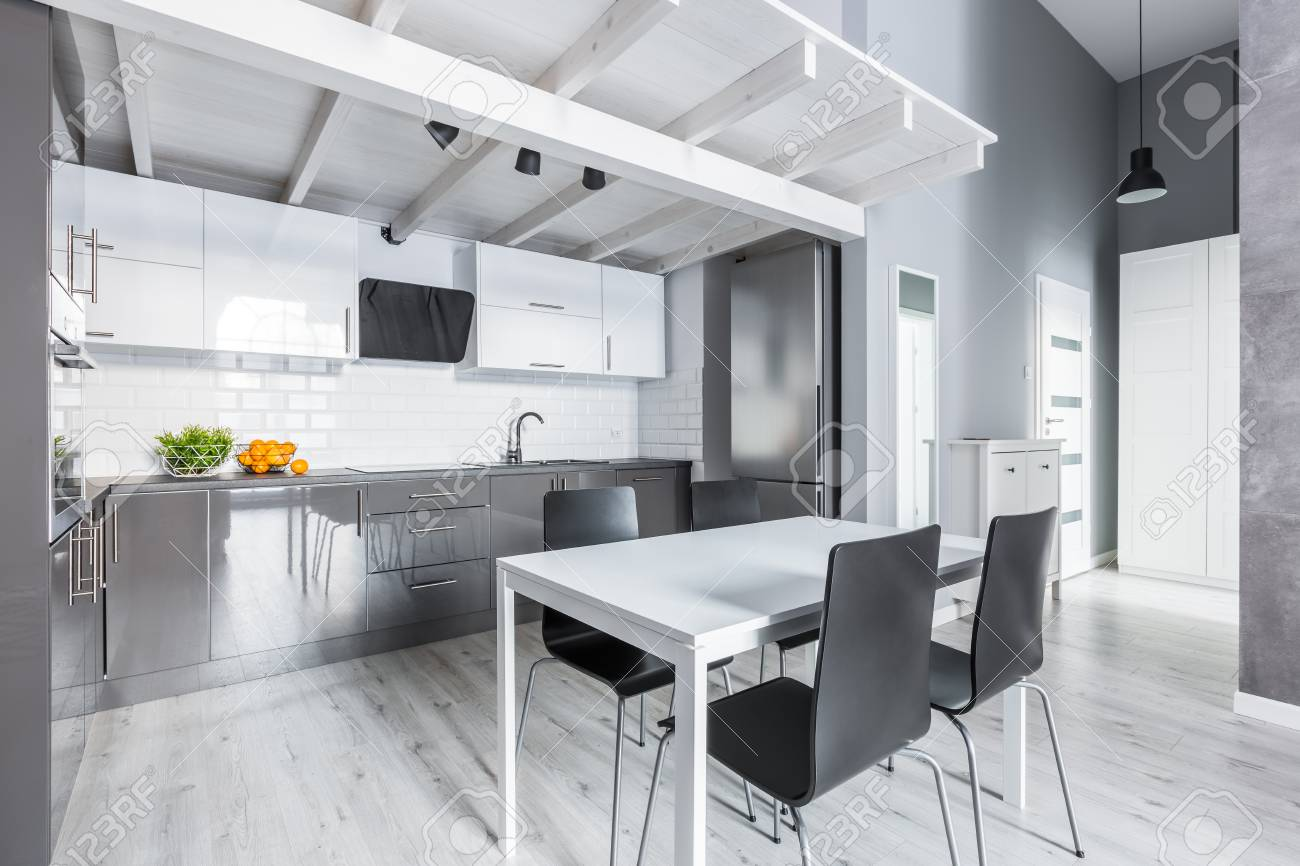 Gray Kitchen With White Dining Table And Black Chairs Stock Photo Picture And Royalty Free Image Image 81421317