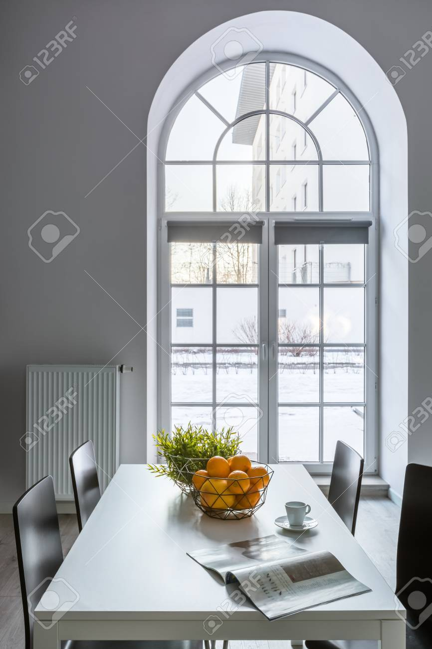 Picture of: White Dining Room With Half Circle Window Table And Chairs Stock Photo Picture And Royalty Free Image Image 80281068