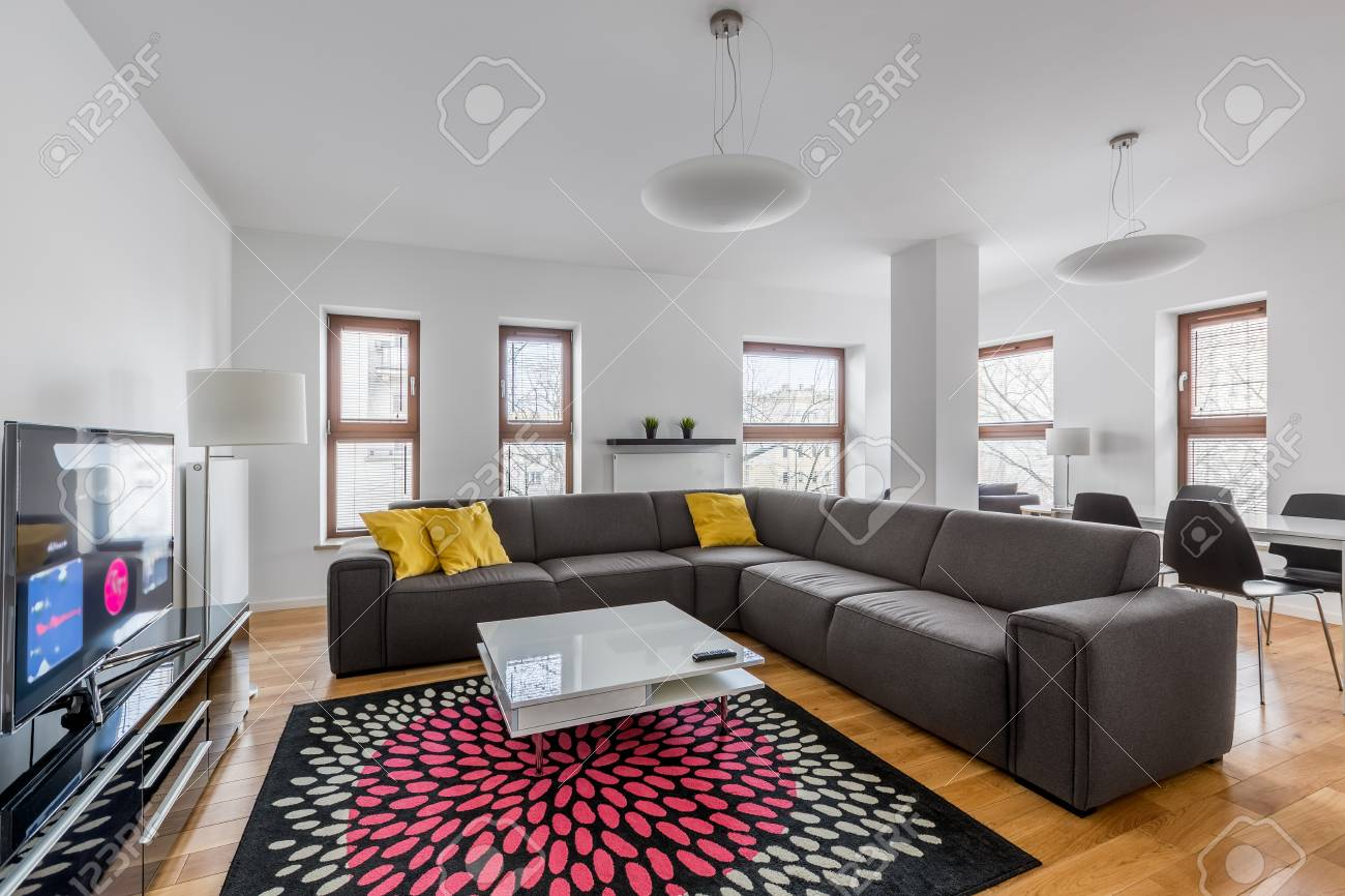Modern Tv Living Room With Extra Large Sofa And Pattern Carpet Stock Photo Picture And Royalty Free Image Image 81162745