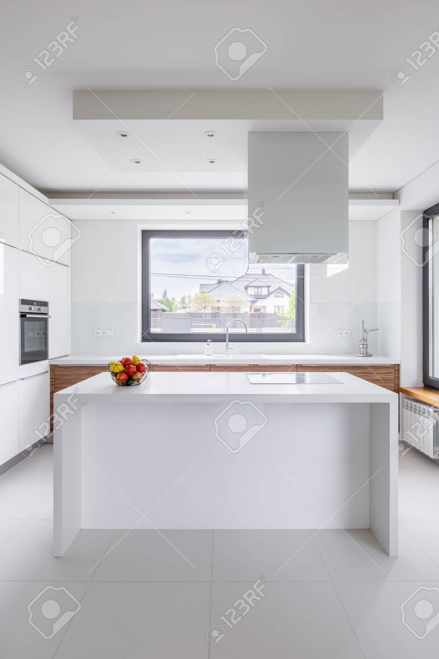 Stylish White Kitchen With Island Exhaust Hood And Window Stock Photo Picture And Royalty Free Image Image 81917711