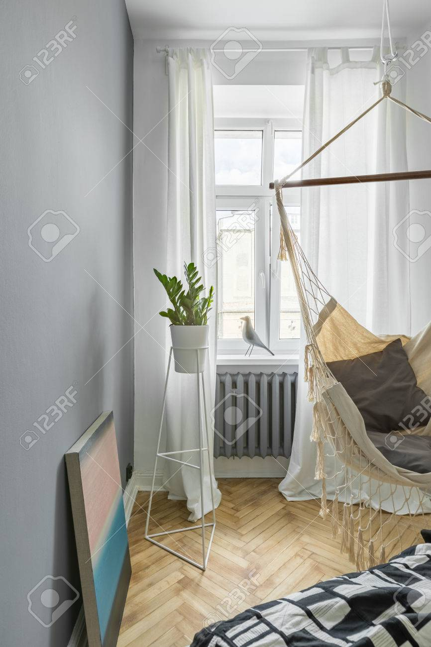 Gray bedroom with diy hammock, bed and window