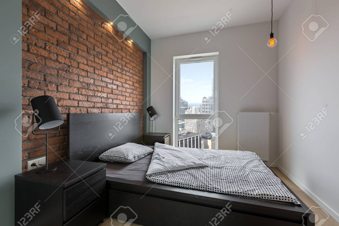 123RF.com & Industrial style bedroom with red brick wall and double bed