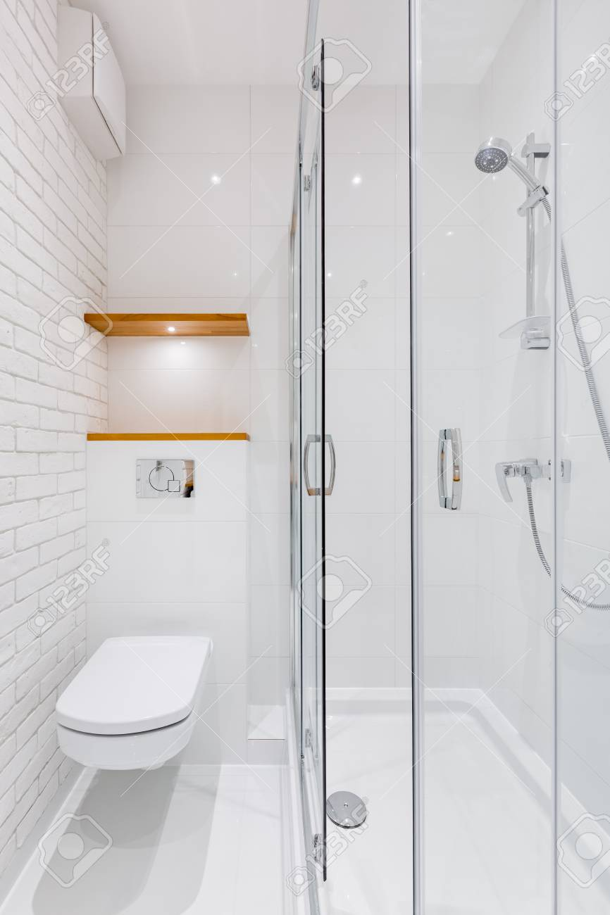 White Bathroom With Modern Brick Tiles, Toilet And Shower Stock ...