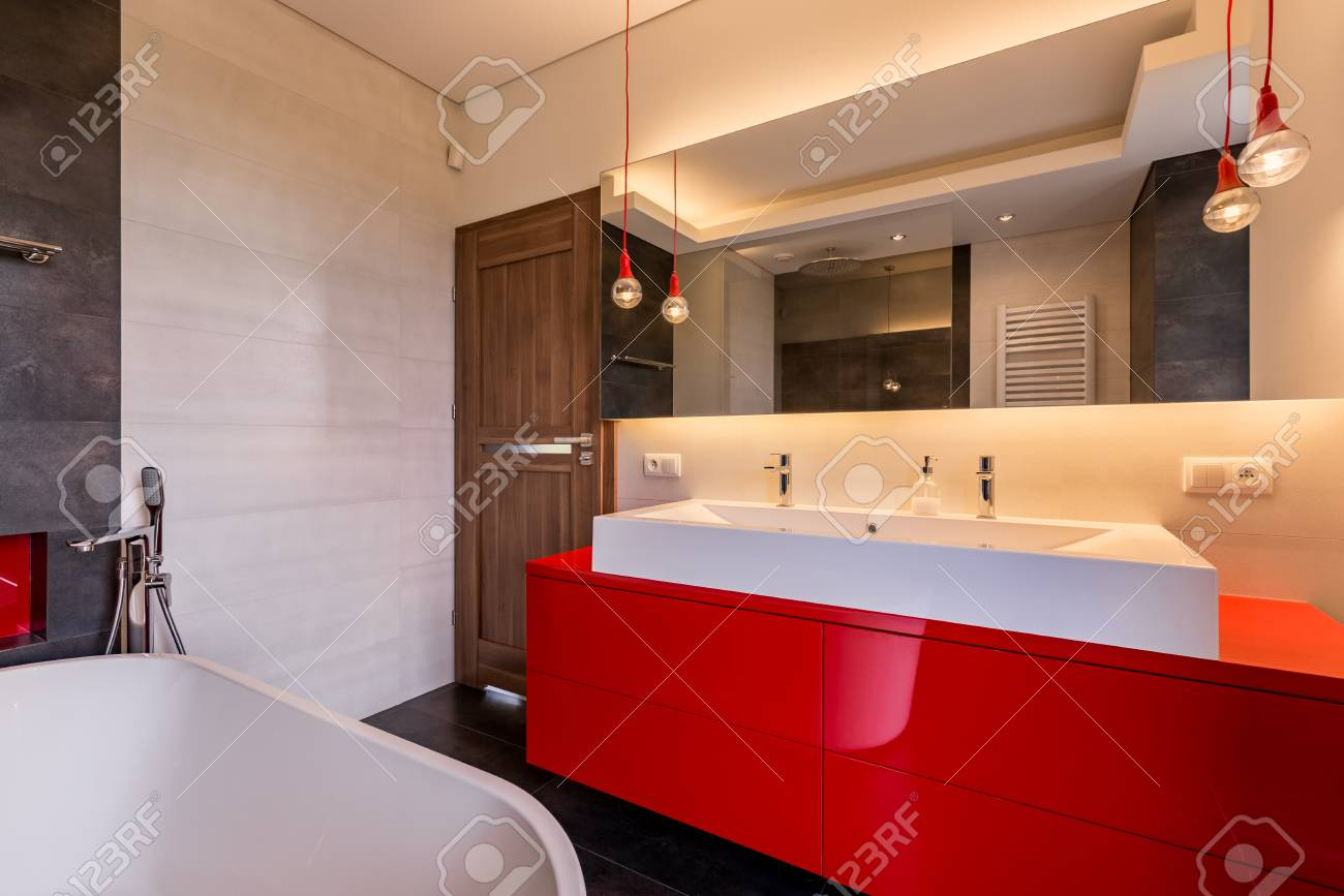 Modern Bathroom With Red Cabinet Bathtub Double Basin And Mirror